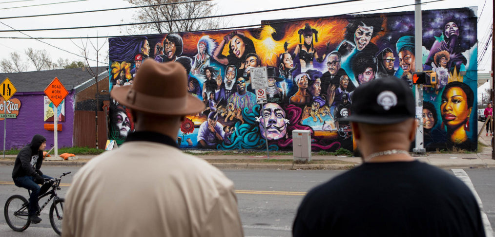 Two men in East Austin look at new mural on 12th & Chicon, Austin TX